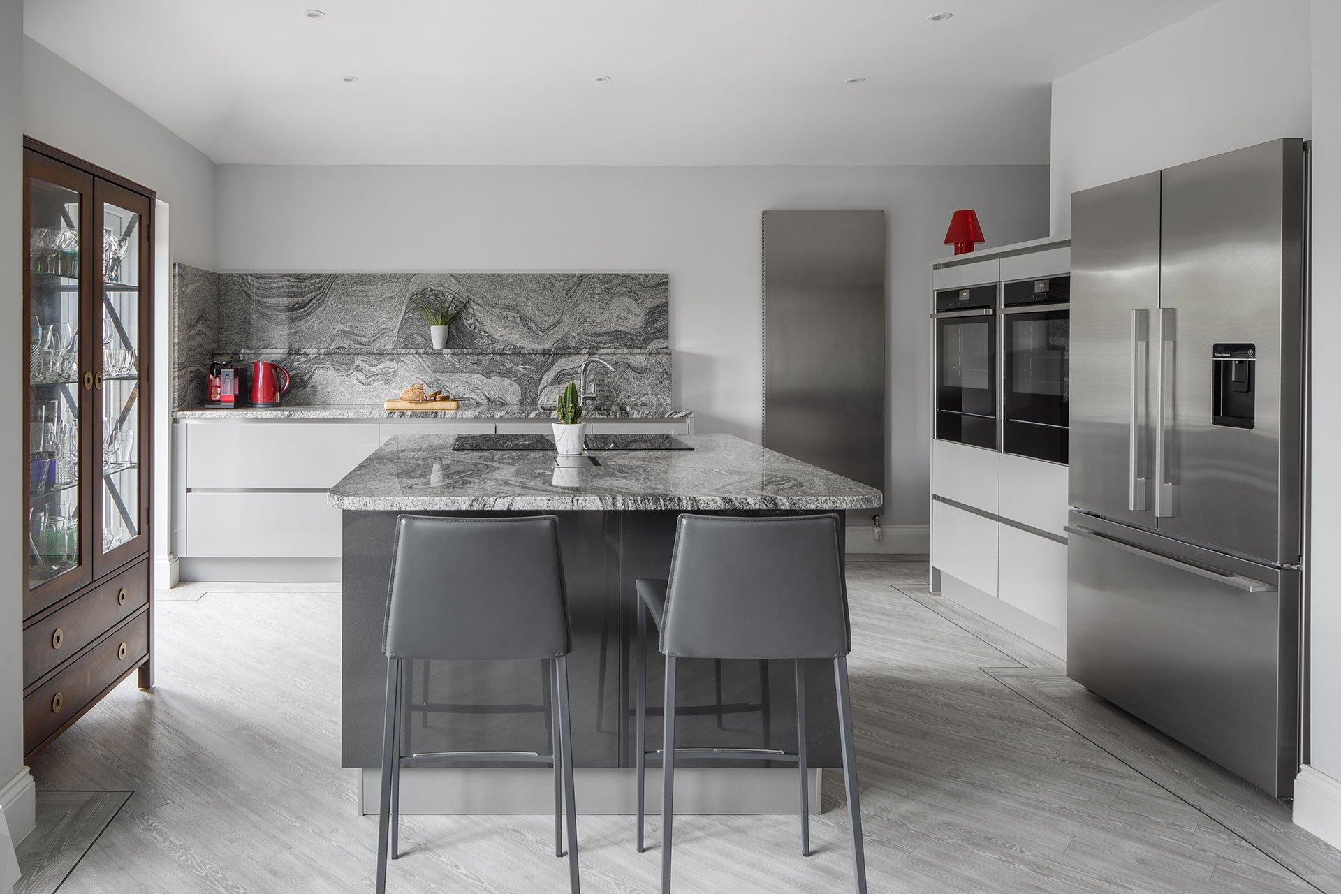 Grey Handleless Kitchen With Grain Matched Granite Worktops Ilkley Leeds Four Seasons Kitchens